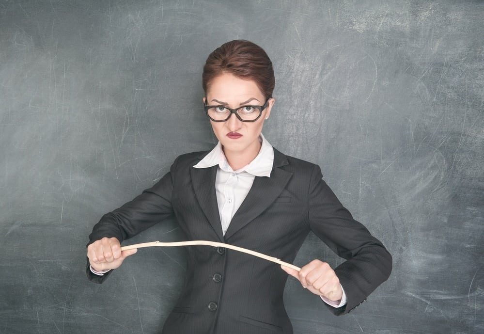 Angry teacher with wooden stick