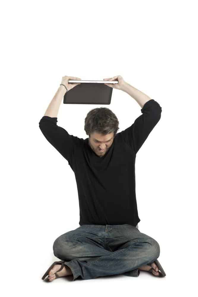 a man about to throw his laptop