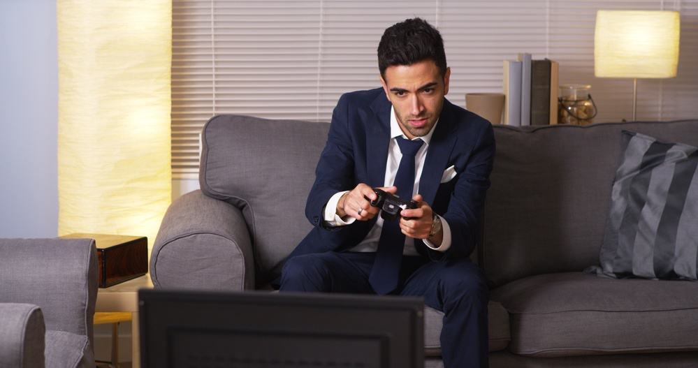 Mexican businessman playing video games at home